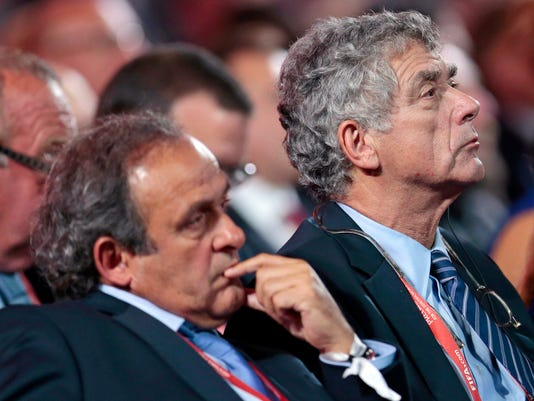 FILE - In this Saturday, July 25, 2015 file photo, UEFA President Michel Platini, left, and FIFA vice president Angel Maria Villar Llona attend the preliminary draw for the 2018 soccer World Cup in Konstantin Palace in St. Petersburg, Russia. UEFA said Thursday, July 27, 2017 vice president Angel Maria Villar, in jail in Spain on suspicion of corruption, has resigned. (AP Photo/Ivan Sekretarev, File)