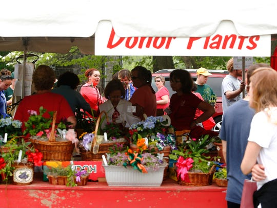 Plant sales are brisk on Saturday, the last day of the Wilmington Flower Market at Rockford Park.