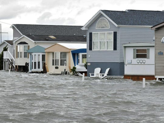 In this file photo, homes in Warren's Park at 51st Street and Coastal Highway in Ocean City were surrounded by flood water pushed in from the Assawoman Bay in the aftermath of Hurricane Sandy in October 2012.