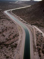 A Central Arizona Project canal stretches across the desert, bringing much-needed water from the Colorado River to Phoenix.