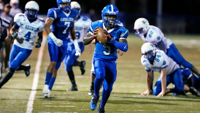 Middletown's E.J. Washington downshifts as he heads for the end zone on his second punt return for a touchdown in the Cavs' 49-7 win against St. Georges at Cavalier Stadium Thursday.