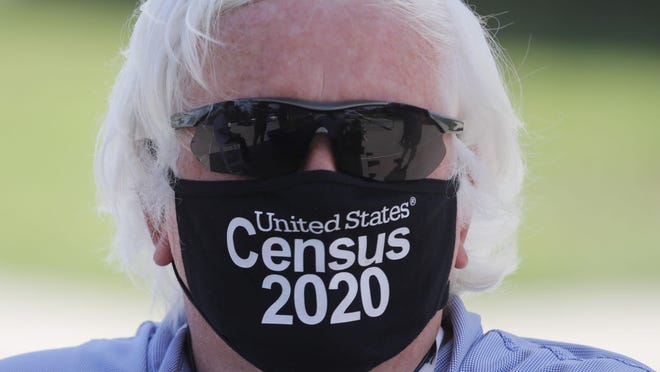 Amid concerns of the spread of COVID-19, census worker Ken Leonard wears a mask as he mans a U.S. Census walk-up counting site in Greenville, Texas, in this Aug. 5 file photo. [AP ARCHIVE]