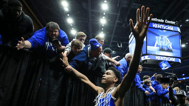 Kentucky Shai Gilgeous-Alexander greets the fans after winning the 2018 SEC Championship Sunday afternoon in St. Louis after defeating Tennessee 77-72.
