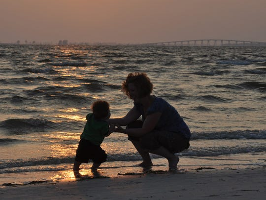 Fort Myers resident Ryan Hambling's second-place winning shot of his wife, Jennifer Hambling and her son, 9-month-old Blake on Fort Myers Beach.