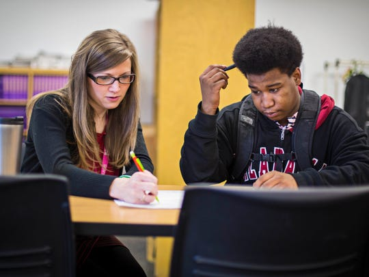 Alyssa McDonald, English teacher and academic interventionist,  works with Norris Hildreth, North High senior, March 9, 2016.