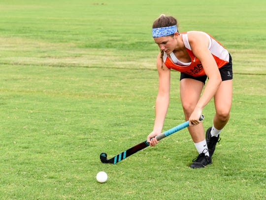 Josie Hollamon, upcoming eighth grader at Delmar middle school, passes with a field hockey teammate on Monday July 16.