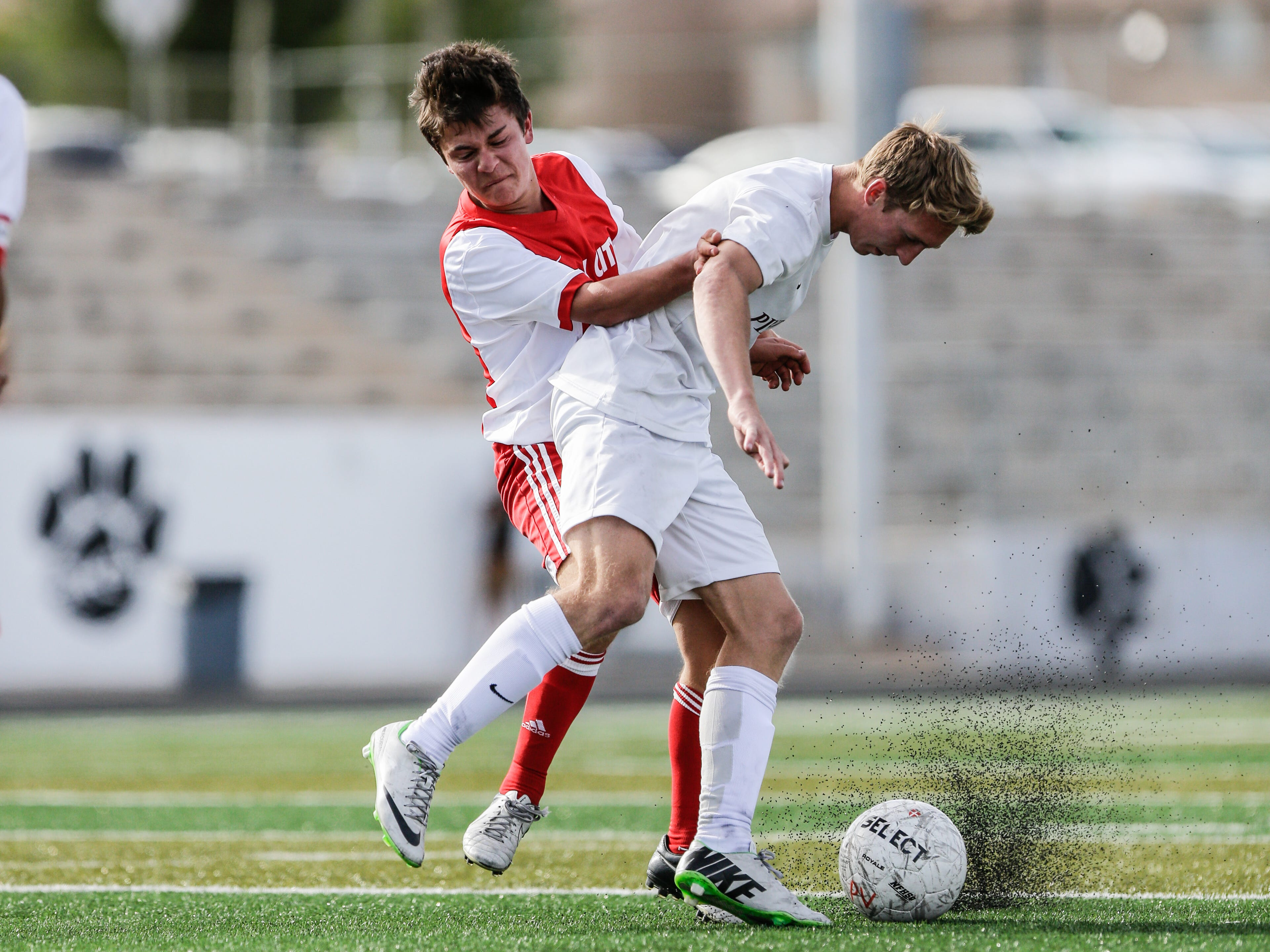 Pine View's Michael Wade battles with a Park City defender for the ball Thursday.