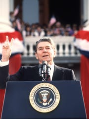 DON RYPKA, AFP/Getty Images President Reagan addresses supporters at an electoral meeting in November 1984, a few days before the presidential election. US President and Republican presidential candidate Ronald Reagan makes the V sign as he addresses supporters at an electoral meeting in November 1984, a few days before the american presidential election.        (Photo credit should read DON RYPKA/AFP/Getty Images) [Via MerlinFTP Drop]