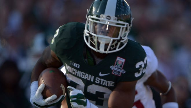 Jeremy Langford (33) is a highly productive running back for Michigan State who will keep pressure off quarterback Connor Cook.