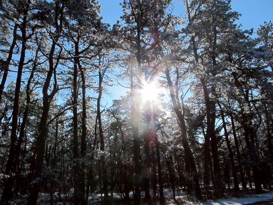 FILE - In this Dec. 11, 2013, file photo, the sun shines
