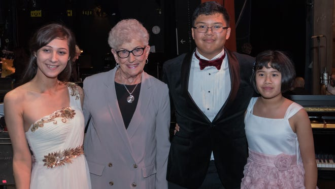 Steinway Society of Riverside County founder Ruth Moir beams with pride at the stellar performances of young pianists Marie Ananian, 20; Matthew Gurning, 14; and his sister Kathleen, 12.
