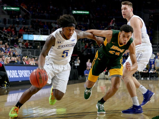 SDSU's David Jenkins Jr. drives to the basket on NDSU's Tyson Ward at the 2018 Summit League Basketball tournament at the Denny Sanford Premier Center in Sioux Falls.