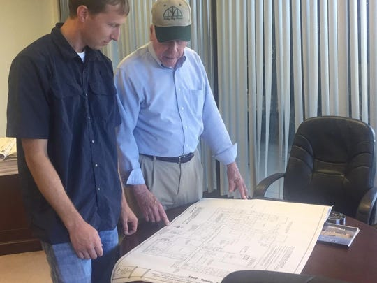 Charles Jones (right) looks over plans for the former