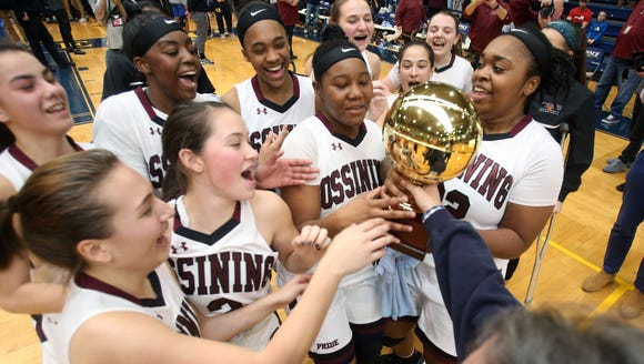 Ossining girls celebrate with the Gold Ball after defeating
