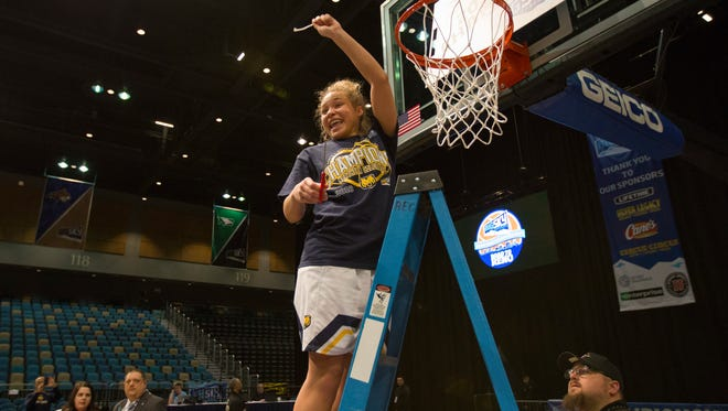 Northern Colorado's Savannah Smith cuts down the nets after their win over Idaho  in an NCAA college basketball game in the championship of the Big Sky Conference in Reno, Nevada.