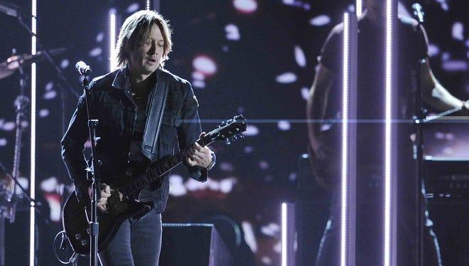 Keith Urban will perform with John Mellencamp on the 49th annual CMA Awards on Nov. 4 at Nashville's Bridgestone Arena.
