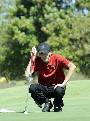 Stewarts Creek junior Shelden Barina reads the slope of the green before putting on hole No. 1 Wednesday at the Class AAA State Golf Tournament.