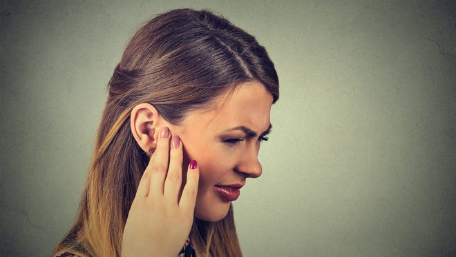 Tinnitus is often associated with a ringing in the ear, but it can also be a roaring, hissing, clicking, buzzing, whistling or chirping.