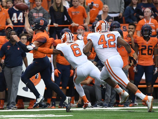 Syracuse quarterback Eric Dungey (2) passes past Clemson linebacker Dorian O'Daniel (6) during the 1st quarter on Friday, Oct. 13, 2017 at the Carrier Dome in Syracuse, N.Y.