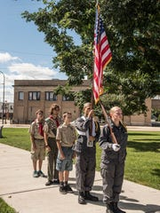 Members of Troop 374 Boy Scouts and Michigan Youth Academy present the colors during the 911 Remembrance ceremony at McCamly Park on Sunday.
