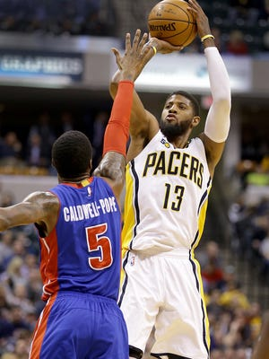 Indiana Pacers forward Paul George (13) attempts a three-pointer over Detroit Pistons guard Kentavious Caldwell-Pope (5) in the first half of their game Wednesday, March 4, 2017, evening at Bankers Life Fieldhouse.