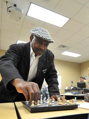 Chess teacher and motivational speaker Eugene Brown makes a move against Tanner Nelson Monday morning at NTC Alternative High School.