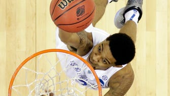 Kentucky's Tyler Ulis shoots against West Virginia in the second half of a college basketball game in the NCAA men's tournament regional semifinals, Thursday, March 26, 2015, in Cleveland. (AP Photo/David Richard) ORG XMIT: CDA