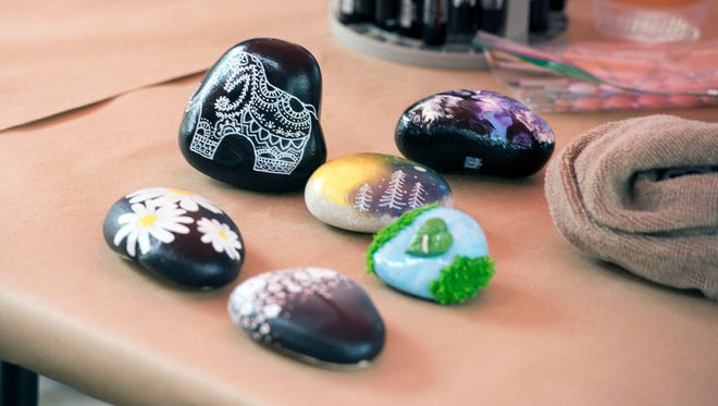 Finished rock paintings Saturday, June 24, 2017 at Woerner Landscape & Pet Supply.  The business welcomed community members to come in and paint rocks to hide around town as part of the Pensacola Rocks phenomenon -- rock painting and hiding has become an international trend, with more than 20,000 people in the Pensacola Rocks Facebook group.