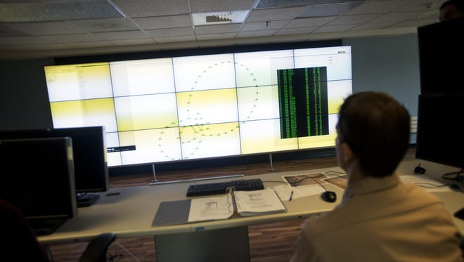 An engineer for the Burlington Electric Department, navigates the new interactive schematic of Burlington's power grid in this 2013 photo.