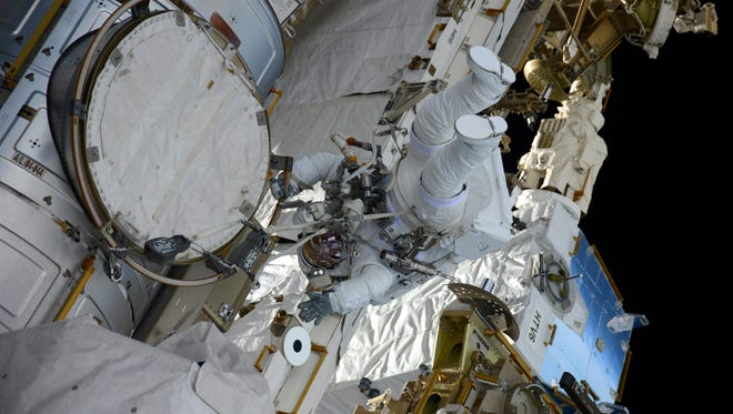 epa05716490 A handout photo made available by the European Space Agency (ESA) shows ESA astronaut Thomas Pesquet during his first spacewalk at the International Space Station (ISS), 13 January 2017 (issued 14 January 2017). Together with NASA astronaut Shane Kimbrough, he spent five hours and 58 minutes outside the Space Station to complete a battery upgrade to the ISS power system.  EPA/ESA/NASA HANDOUT  HANDOUT EDITORIAL USE ONLY/NO SALES