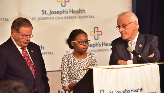 U.S. Sen. Bob Menendez (D-NJ), patient Ziaira Dollar, 18, and U.S. Rep. Bill Pascrell, Jr. (D-NJ-09), discuss efforts to restore federal funding for the Children's Health Insurance Program (CHIP), which covers 9M children from lower-income families, including 112k in NJ. Recently, the Trump Administration announced that the short-term extension of CHIP funding could expire by the end of the month, far earlier than previous projections. Photo by Marko Georgiev/NorthJersey.com