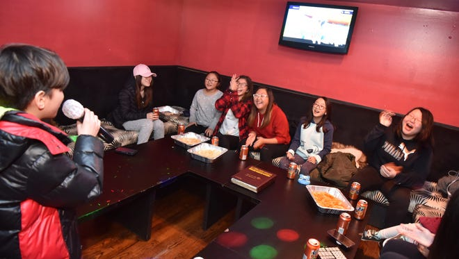 Aaron So, 11, serenades his friends with K-pop hits at Rodeo Karaoke in Paliades Park. Noraebang, as karaoke is called in Korean, occupies an outsize place in South Korean culture.
