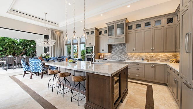 The Newport model, by KTS Homes, features a kitchen with direct access to the outdoor living area.