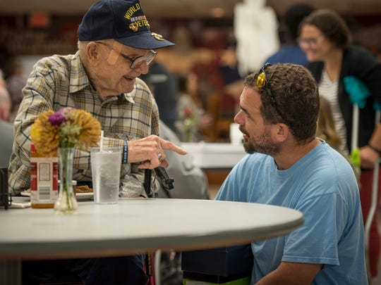 World War II veteran Curtis Spearman, 94, chats with former U.S. Army Sgt. 1st Class Maston Greene, a Clemson University graduate student studying plant pathology at the Richard M. Campbell Veterans Nursing Home in Anderson, S.C., Oct. 21, 2017. Greene was at the home with members of the Clemson Student Veterans Association delivering more than 200 care packages to veterans living there.