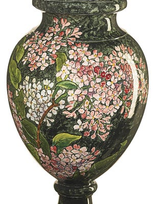 The decoration on this lidded urn made in the late 1800s is what made it worth the $6,100 paid by a bidder at a Rago auction. John Bennett painted this one-of-a-kind decoration.
