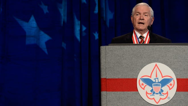In this May 23, 2014, file photo, former Defense Secretary Robert Gates addresses the Boy Scouts of America's annual meeting in Nashville, Tenn., after being selected as the organization's new president. The executive committee of the Boy Scouts of America has unanimously approved a resolution that would end the organization's blanket ban on gay adult leaders and let individual scout units set their own policy on the long-divisive issue.