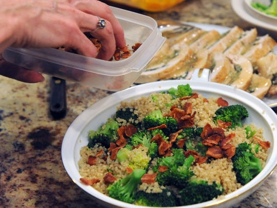 Crumbled crisp bacon adds flavor to the quinoa-broccoli