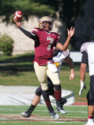 Iona Prep quarterback Robert Madison throws the ball for a touchdown during the fourth quarter against St. Anthony's at Iona Prep in New Rochelle on Sunday.  Iona won 40-30.