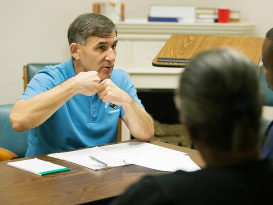 Dr. Alan Gruning consults with patients on Tuesday