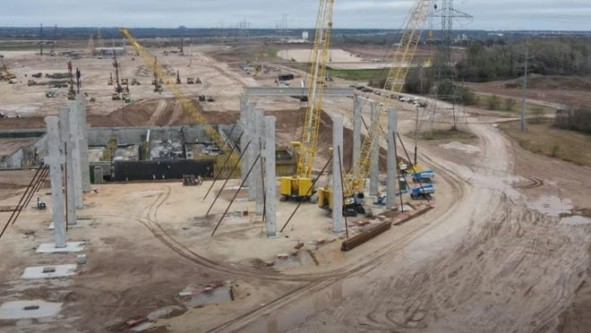 This image taken from drone video shows construction progress at the Tesla site in Travis County on Nov. 29.
