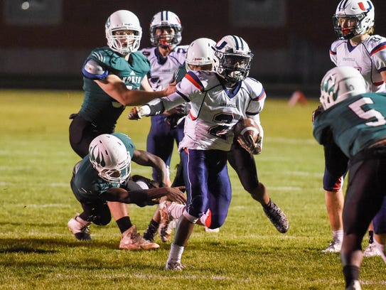 Urbandale's Henry Drake (2) fights his way down field