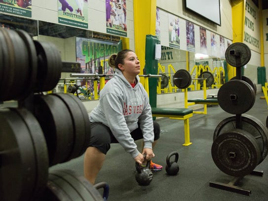 Serina Calderon, lifts kettlebell weights while working out with personal trainer Caleb Hull at the Mayfield High School weight room on Thursday, Dec. 14, 2017.