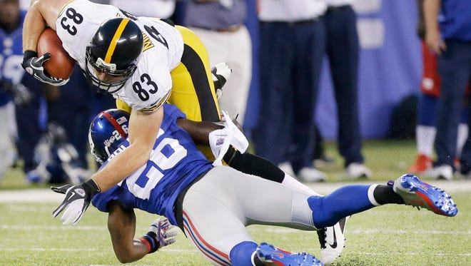 Giants strong safety Antrel Rolle upends Pittsburgh Steelers tight end Heath Miller  in the first quarter of Saturday night's preseason  game in East Rutherford, N.J.