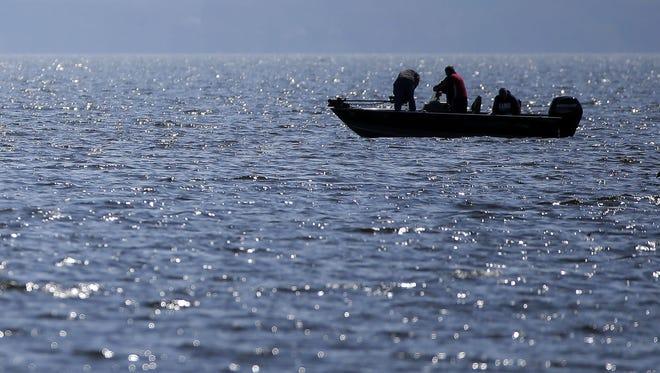 Fishermen and wildlife enjoy the water Sunday on Lake Winnebago near Neenah.