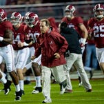 Alabama head coach Nick Saban leads the team onto the field for warmups at Bryant-Denny Stadium in Tuscaloosa, Ala. on Saturday November 7, 2015.