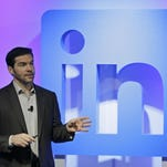 """LinkedIn CEO Jeff Weiner speaks during a product announcement at his company's headquarters, Thursday, in San Francisco. LinkedIn wants to become more useful to workers by adding personalized news feeds, helpful messaging """"bots"""" and recommendations for online training courses, as the professional networking service strives to be more than just a tool for job-hunting."""