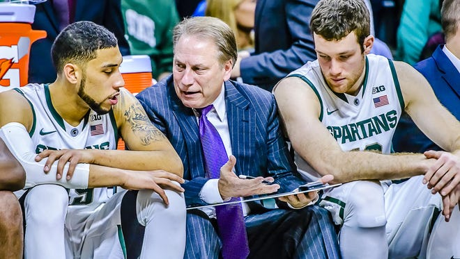 MSU Tom Izzo instructs Denzel Valentine, left, and center Matt Costello during last season's game against Penn State in East Lansing.