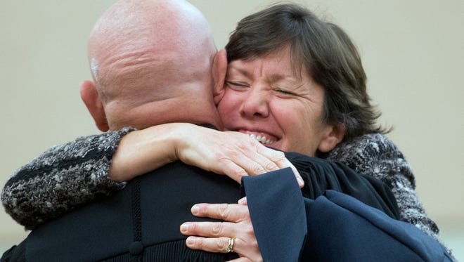 Judge Michael Flannelly, is hugged by his wife Peggy after sworn in as judge.