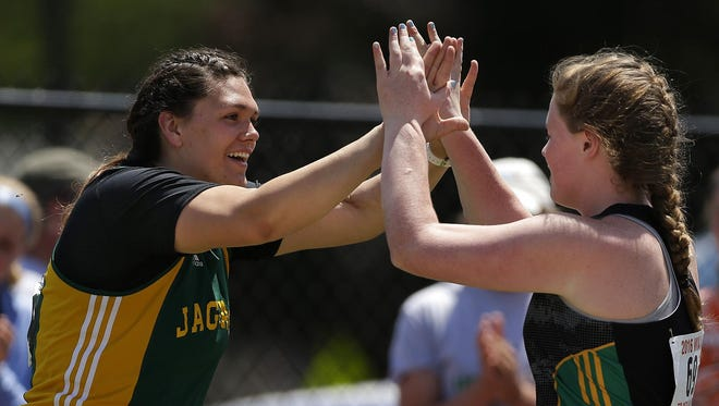 Ashwaubenon's Kris Lindow congratulates teammate Erin Dunning after Dunning made her winning throw in the Division 1 shot put during the WIAA state track and field meet at Veterans Memorial Stadium in La Crosse on Saturday.
