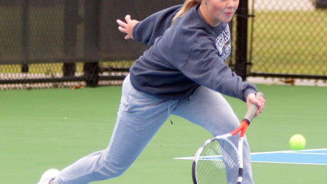 Newton High School tennis player Shelby Spreier competes in doubles play at the Newton Invitational.